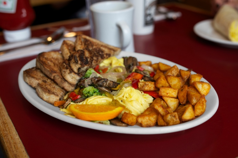 The garden scramble with raisin bread toast at Hole in One in Orleans, MA.