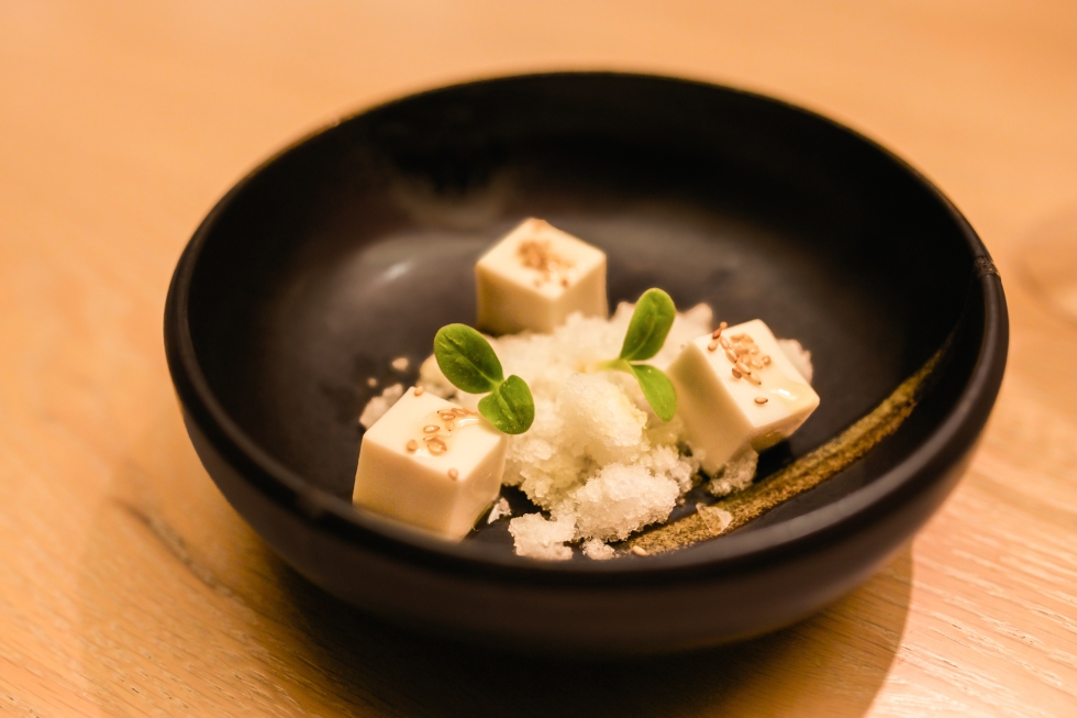 """Andalusian tofu."" Cubes of mock tofu made from almond soup, with clarified gazpacho."